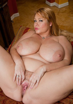 Puffy mature squeezing her fat tits and caressing hot pussy